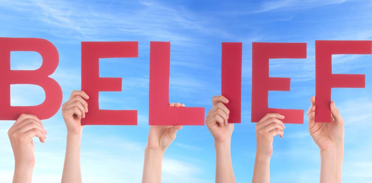 Hands holding Belief sign