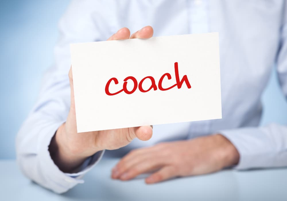Person with a Coach label